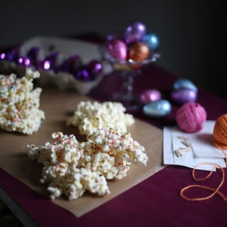 popcorn on a table with purple eggs