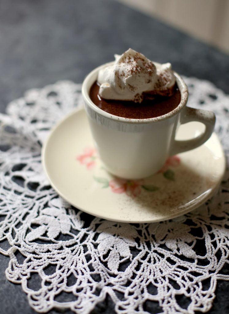 hot chocolate on a white doily
