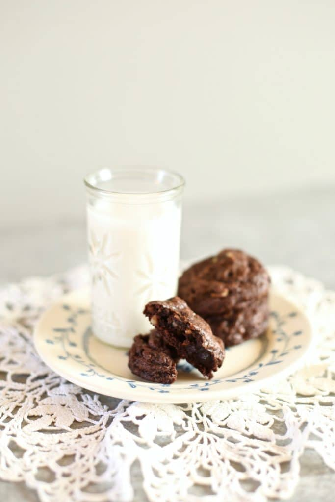 Cookies on a dish with milk alongside