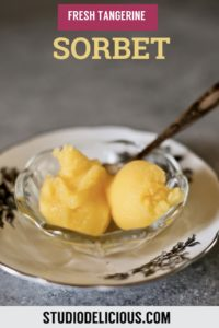 two scoops of sorbet in a glass bowl
