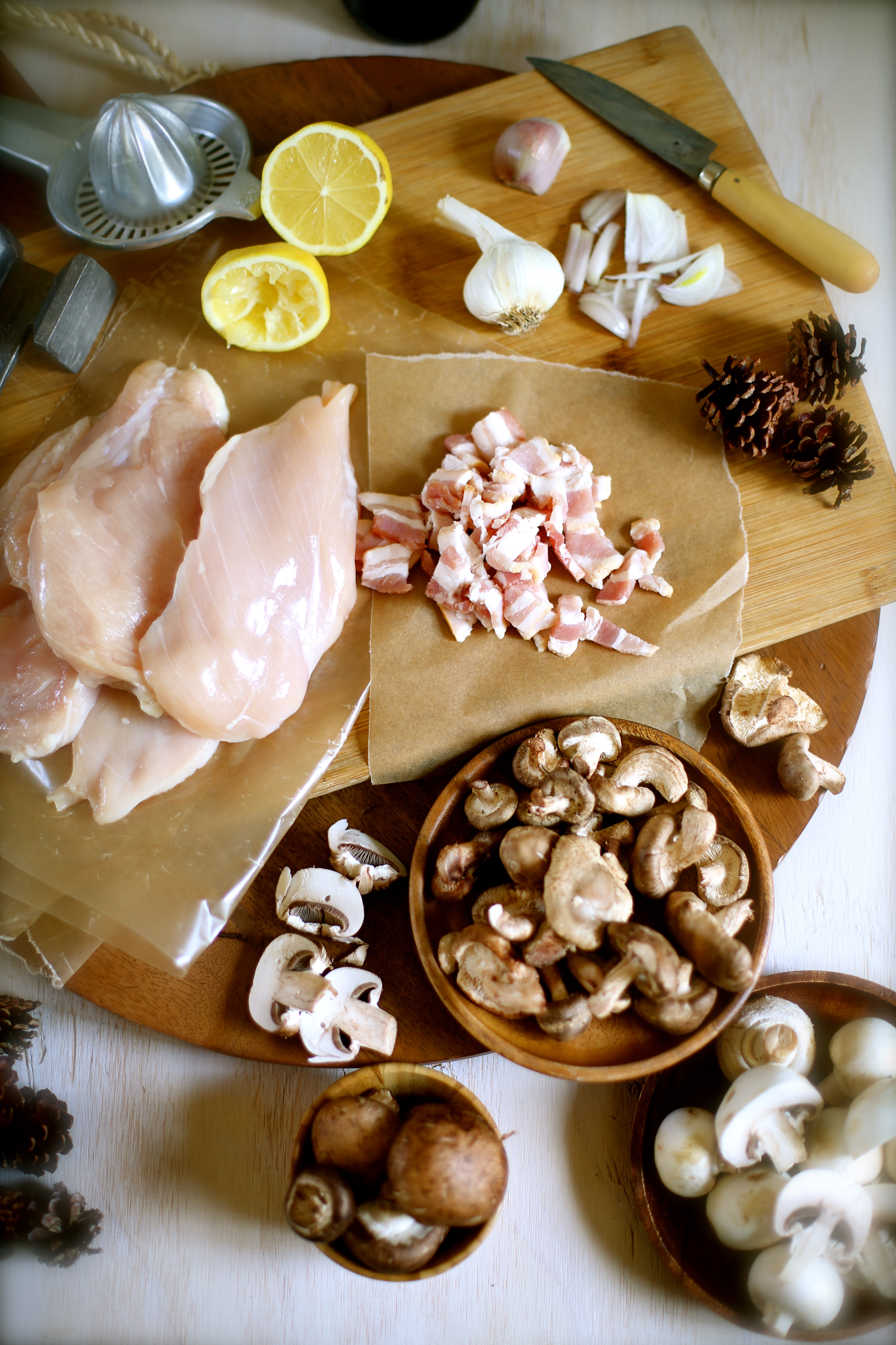 Ingredients for Chicken Marsala on a cutting board