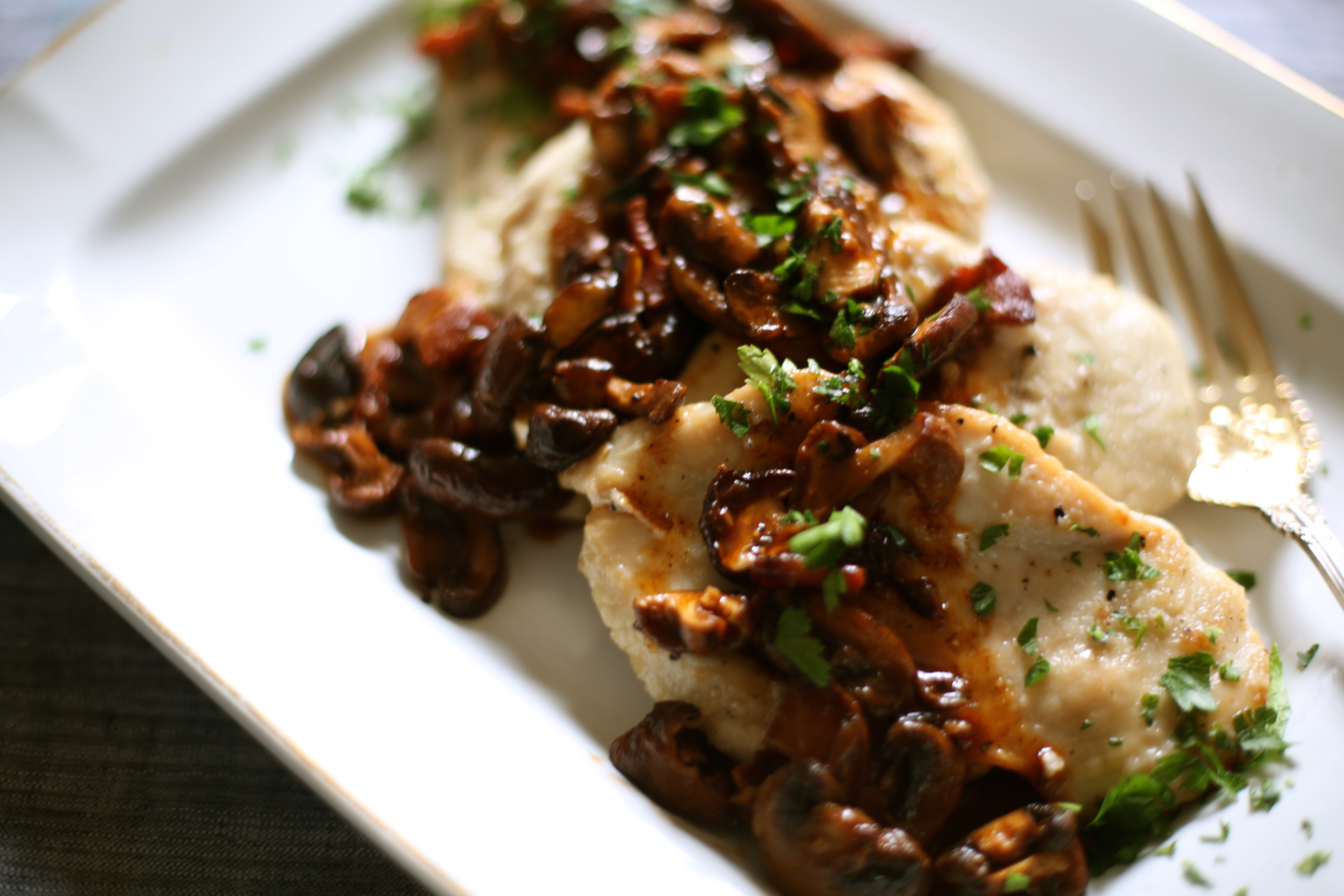 Pieces of Chicken Marsala on a serving platter