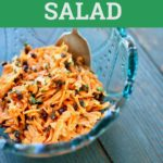 Carrot salad in a blue glass bowl bowl