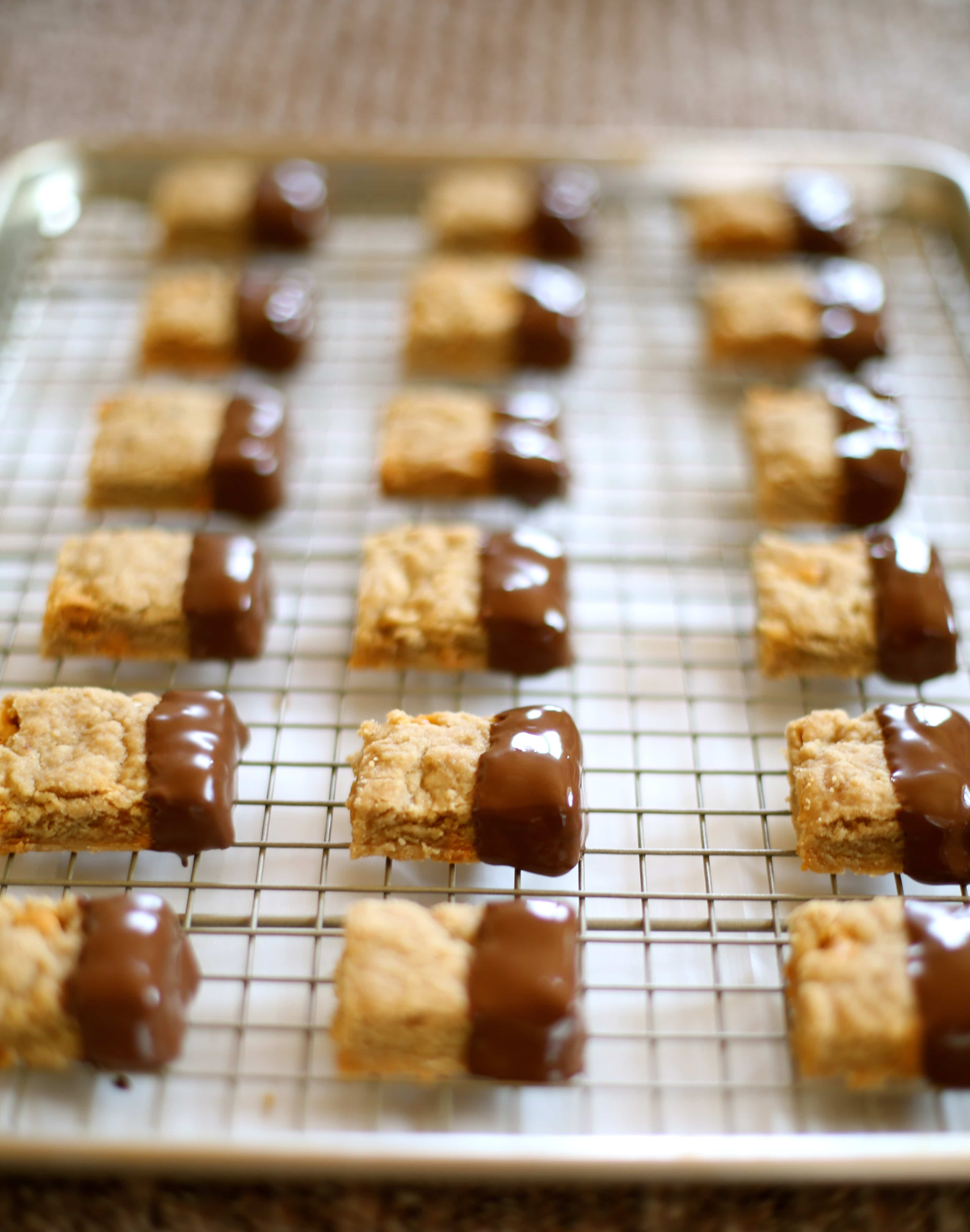 Shortbread cookies dipped in Chocolate on a cooling rack