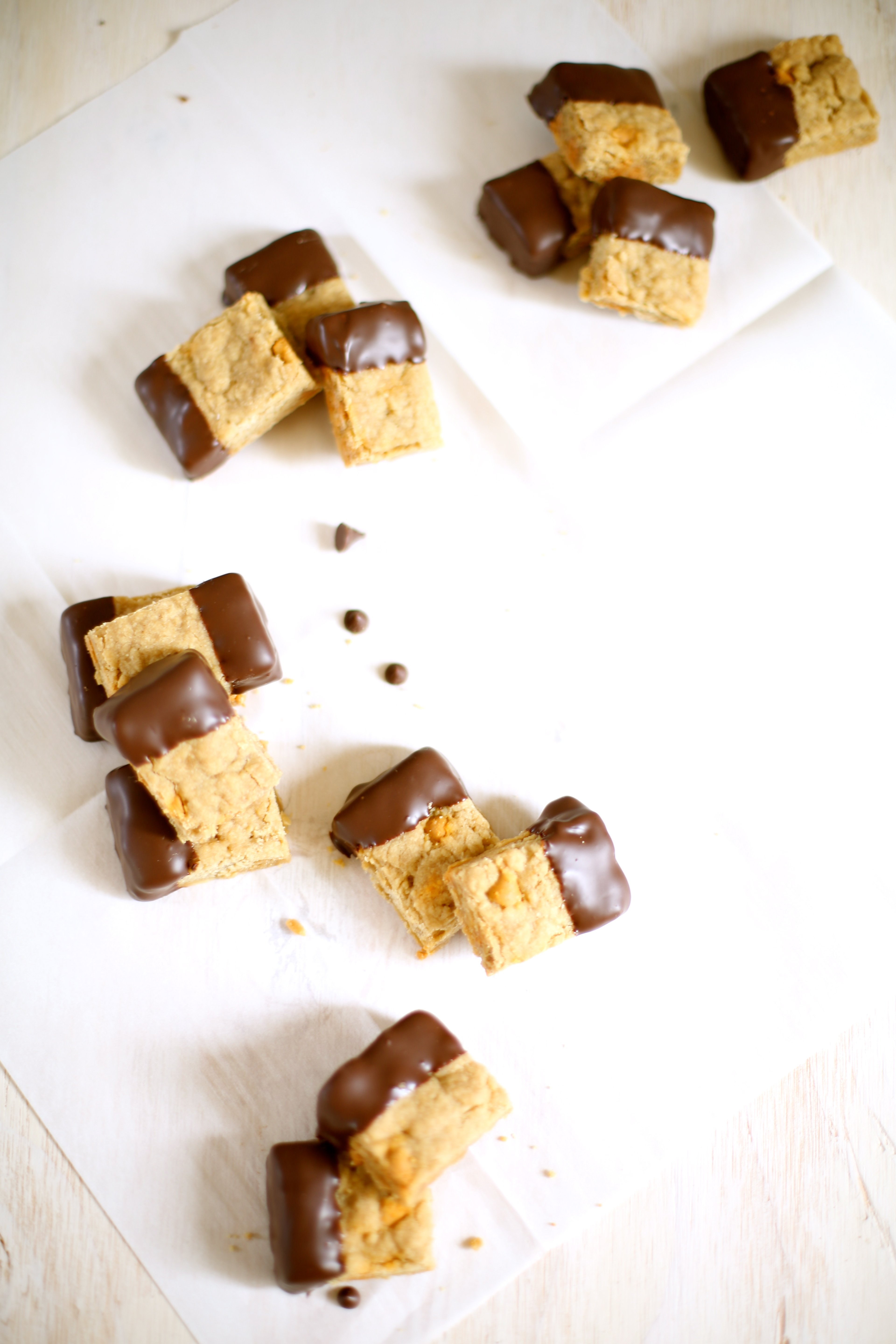 cookies dipped in chocolate on a white table