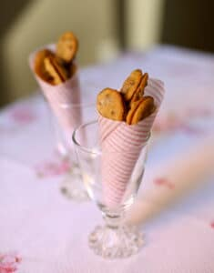 small cookies in a pink cone in a glass