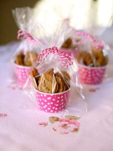 small chocolate chip cookies in pink cups with cellophane