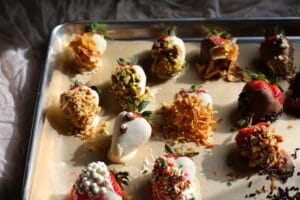 chocolate dipped strawberries on a sheet