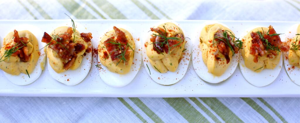 Deviled Eggs with candied bacon and fresh dill