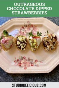 chocolate dipped strawberries on a flowery plate
