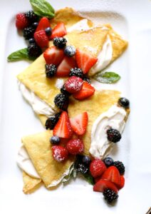 berry crepes on a white platter