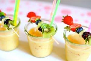 frozen fruit slush with fresh fruit skewers