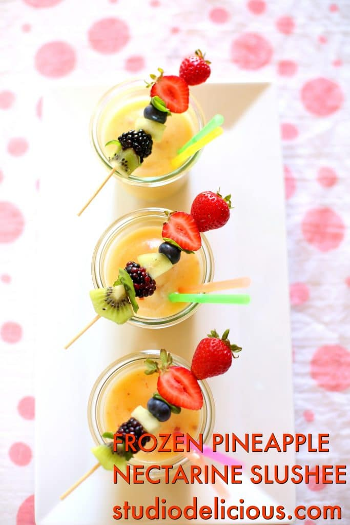 Frozen Pineapple Nectarine Slushee on a white platter with polka dot background and text and web address on the bottom