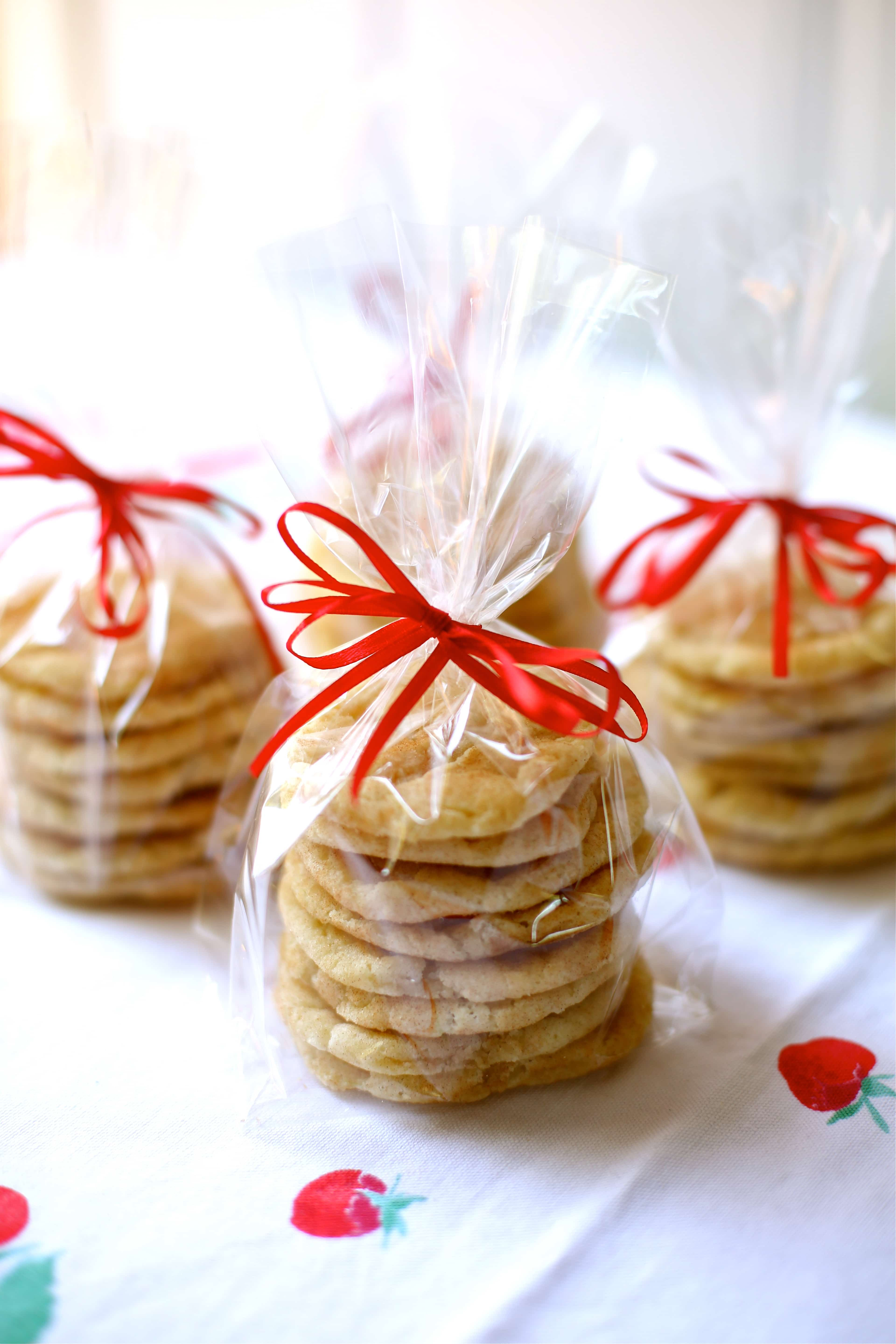 cookies in cellophane bags with red ribbons