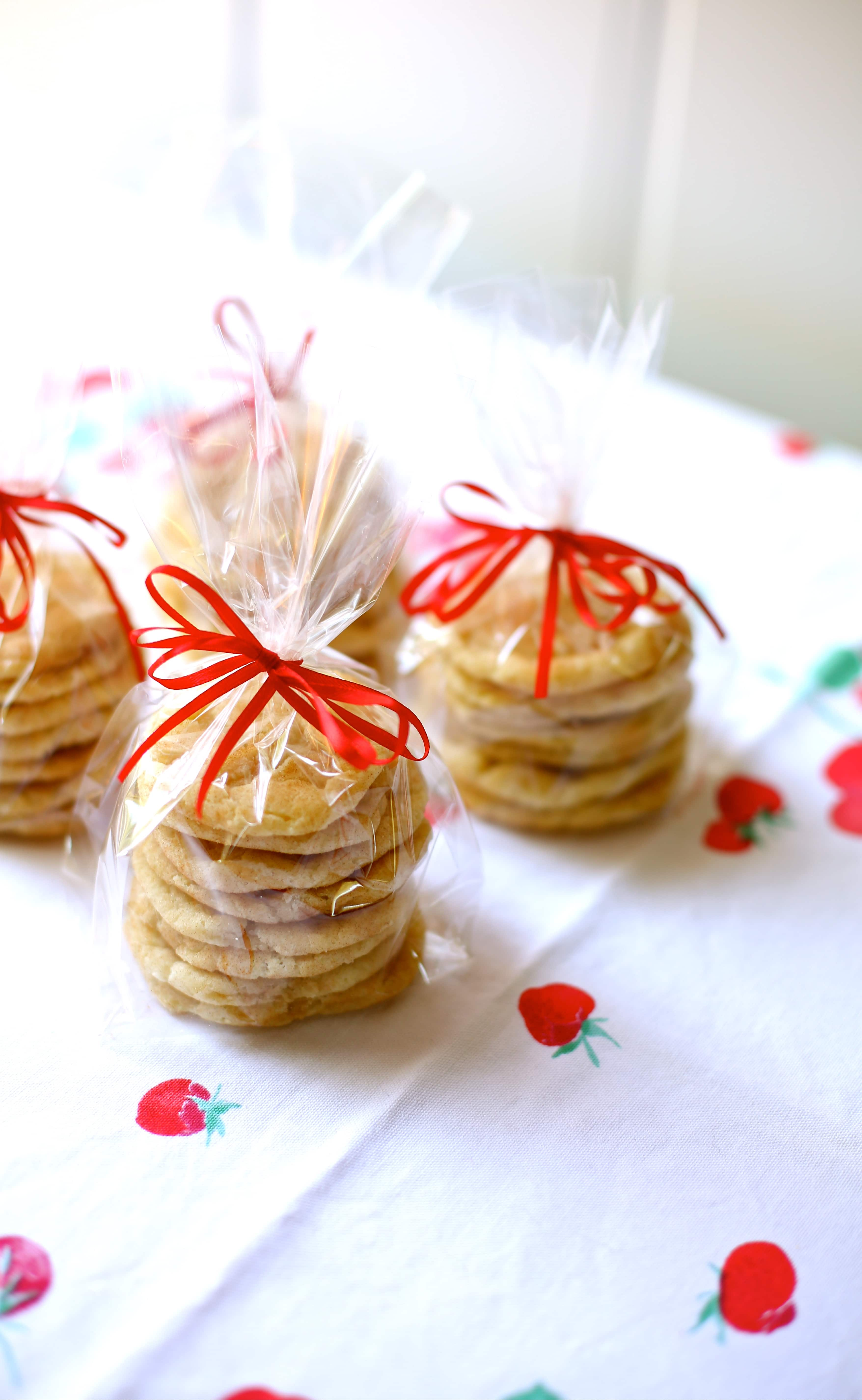cookies in a celophane bag with red ribbon