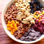 oats and nuts and dried fruit in a bowl
