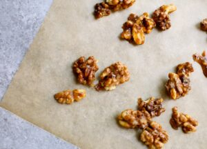 candied walnuts on parchment paper