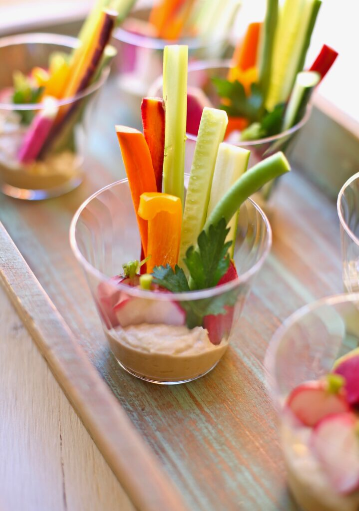 Veggie Cups with Hummus on a wooden tray