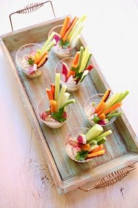 veggies in cups on a wooden board