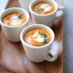 Three cups of Creamy Pumpkin Soup By Studio Delicious