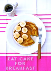 Pancakes on a pink tablecloth