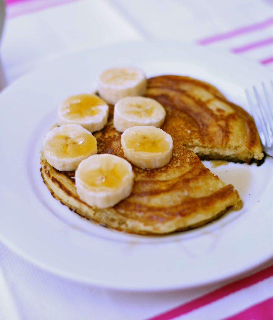 Peanut Butter Banana Pancakes on a white plate