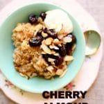 Cherry Almond Oatmeal in a blue bowl with vanilla yogurt