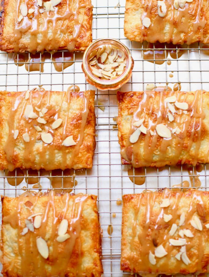 Apple Butter Hand Pies are cooling on a wire rack