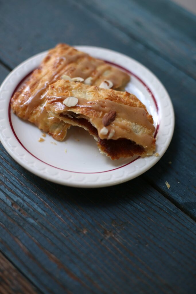 Apple Butter Pies on a small white plate by Studio Delicious