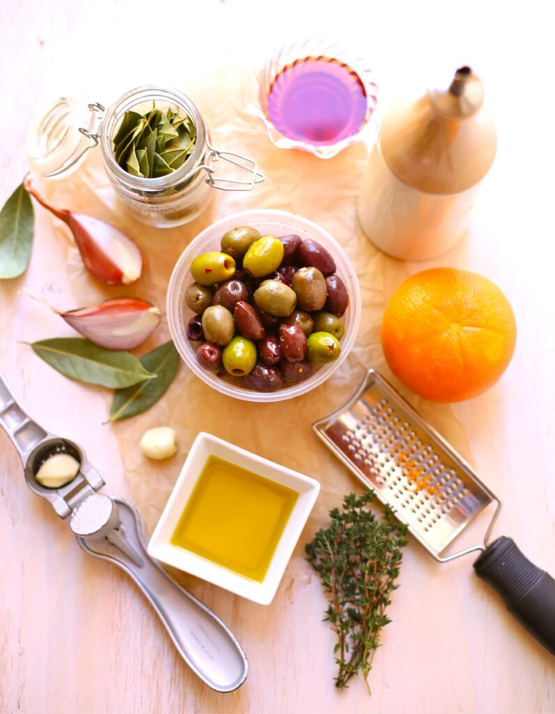Ingredients for Festive Party Olives like shallots bay leaf red wine vinegar olive oil, orange and thyme