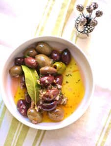 Festive Party Olives in a white bowl by Studio Delicious.com