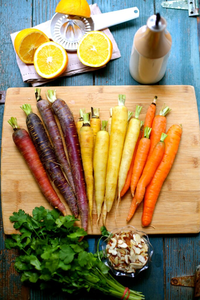 Ingredients for Citrus Roasted Carrots, orange, parsley, almonds and olive oil and carrots