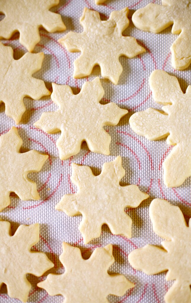 White Chocolate Snowflake Cookies unfrosted on a white background