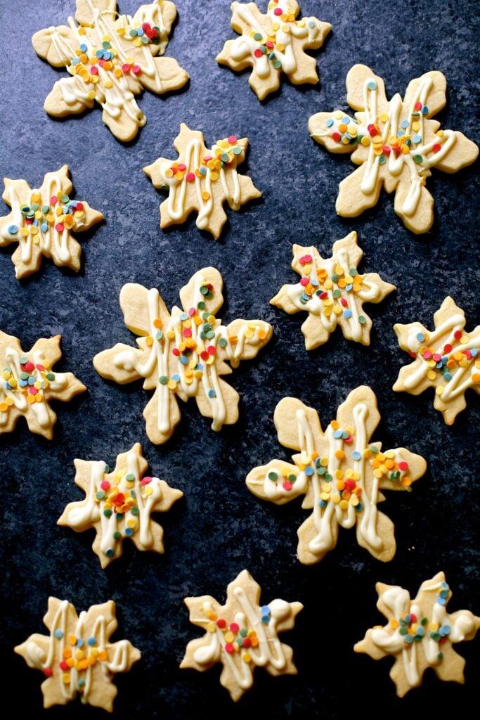 White Chocolate Snowflake Cookies on a black backdrop