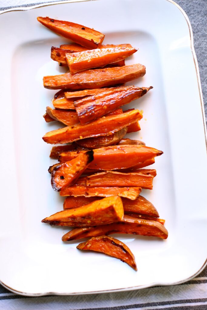 Spicy Roasted Sweet Potatoes with Yogurt Sauce shown plain on a white tray