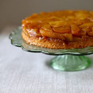 Apple Upside Down Cake on a green glass cake stand