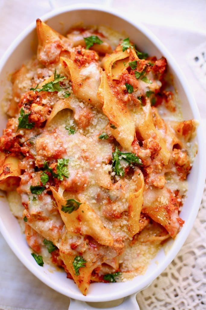 Baked Pasta with Chicken Sausage in a white casserole dish