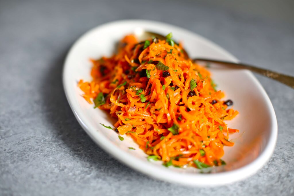 Modern Carrot Salad on a white plate and gray table