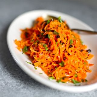 carrot salad on a white platter