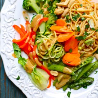 vegetables and noodles on a white plate