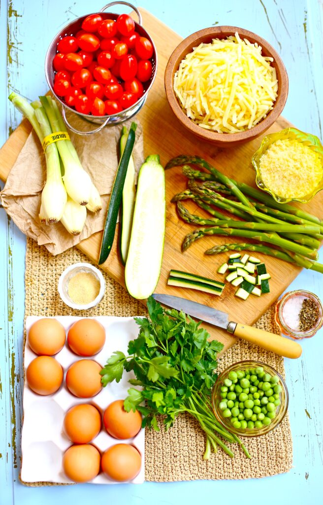Ingredients for Spring Vegetable Fritattas, tomatoes, hash browns, onion, peans parsley, asparagus, zuchinni