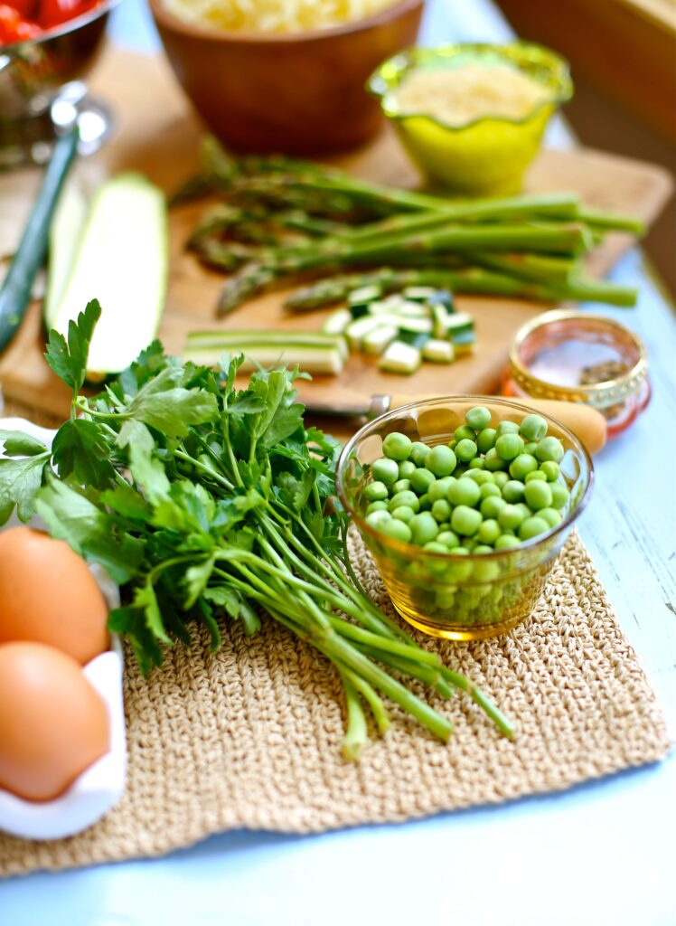Fresh English Peas and asparagus and parsley for Spring Vegetable Fritattas