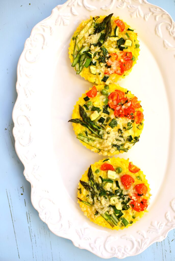 Three Spring Vegetable Fritattas on white plate with blue background