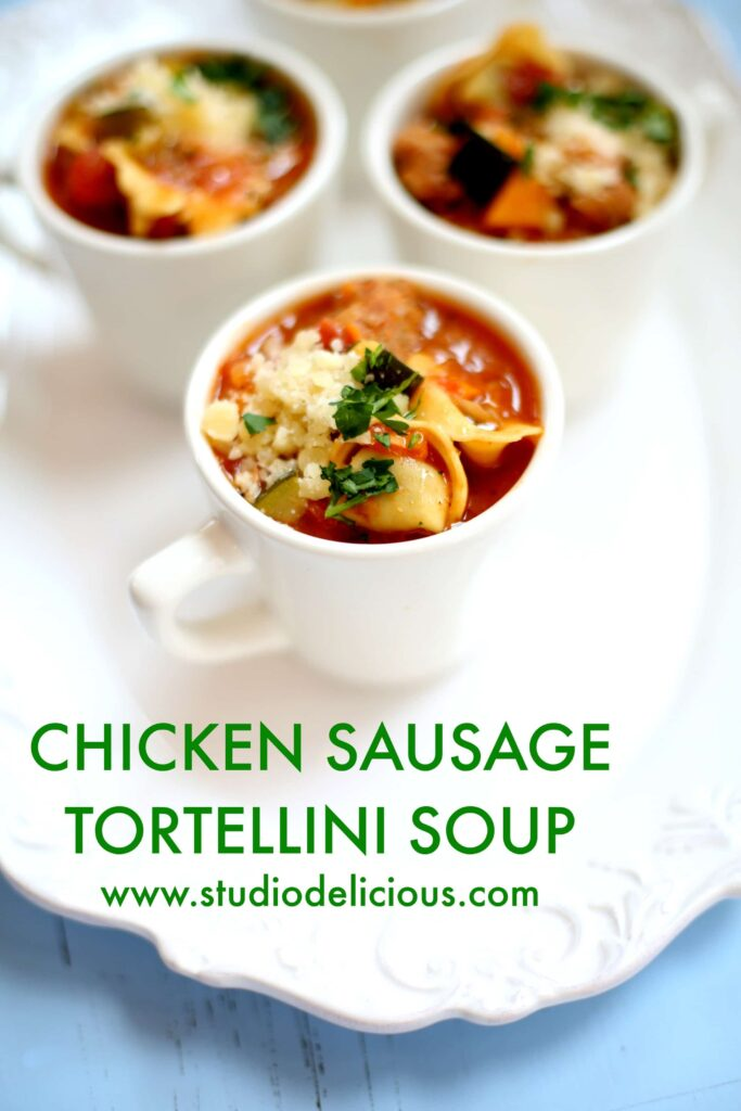 CHICKEN SAUSAGE TORTELLINI SOUP ON WHITE PLATTER