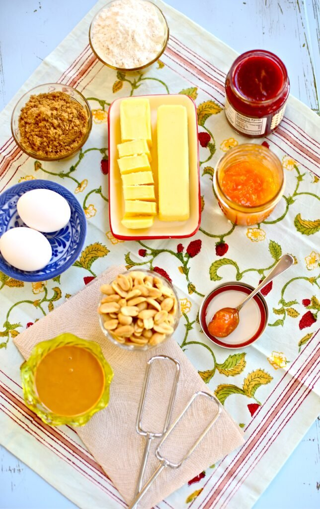 Ingredients for Peanut Butter and Jam Cookies: Butter, eggs, flour, penaut butter, jam, brown sugar and peanuts