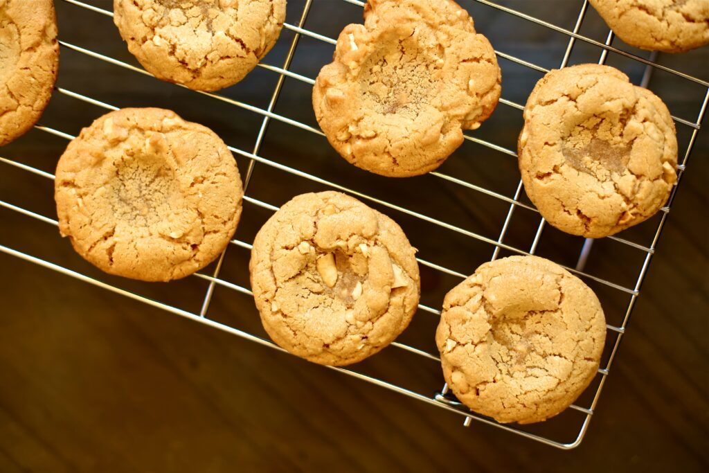 Peanut Butter and Jam Cookies on a cooling rack from the oven