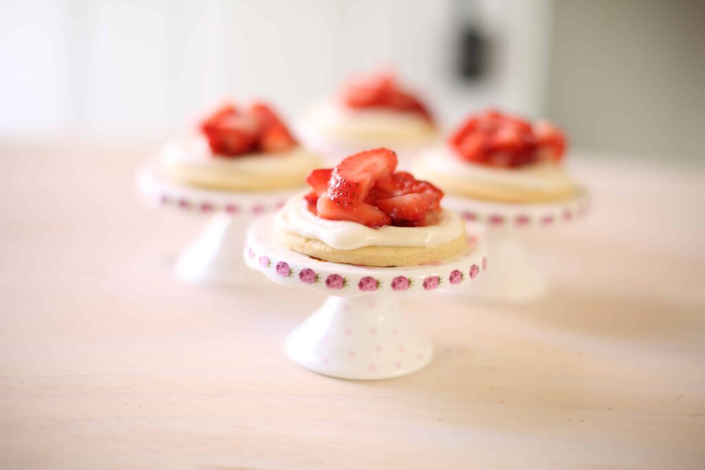 Strawberry Shortcake Cookies on a small pedestal