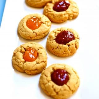 Cookies with jam on a white platter