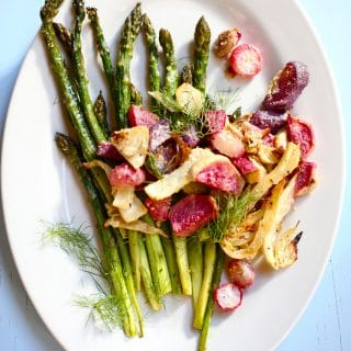 Roasted Spring Vegetables with Vinaigrette on a white platter for serving
