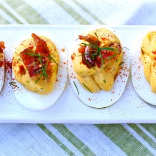 deviled eggs on a white tray